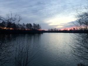 Distant Sun Rise Over Blue Lake 1